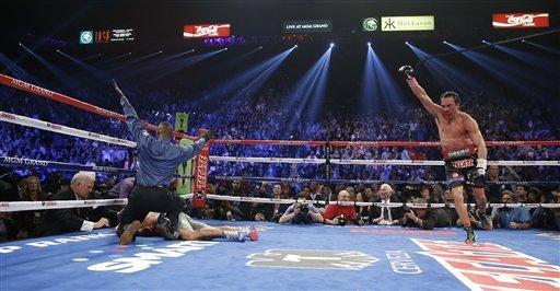 Explota 'Dinamita': derrota Márquez por fulminante KO a Manny Pacquiao