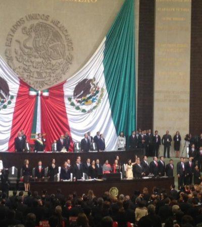 En medio de gritos y aplausos, con protestas y heridos, Peña Nieto jura como Presidente
