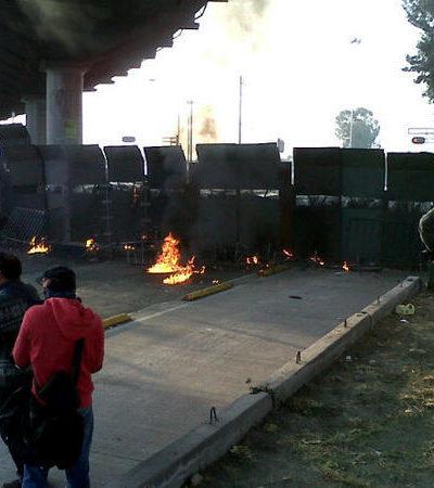 Protestas, petardos y gases lacrimógenos en los alrededores de San Lázaro, preámbulo de la toma de protesta de Peña Nieto