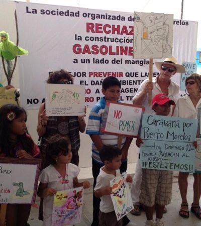 Marchan en Puerto Morelos para celebrar el negación de permisos al 'Dragon Mart Cancún' y rechazan gasolinera
