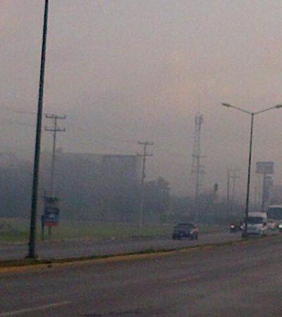 AMANECE CANCÚN BAJO HUMO: Provocan quemas en terrenos de colonias irregulares extensa humareda