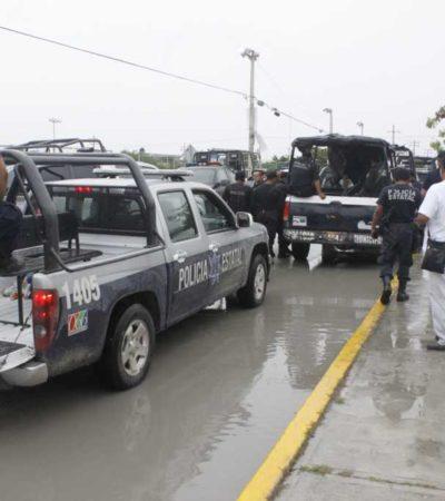FOTOGALERÍA: Se pelean policías municipales y estatales en Cancún por 2 detenidos tras ejecución en Villas Otoch