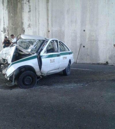 Choca taxi contra puente en Cancún: un herido