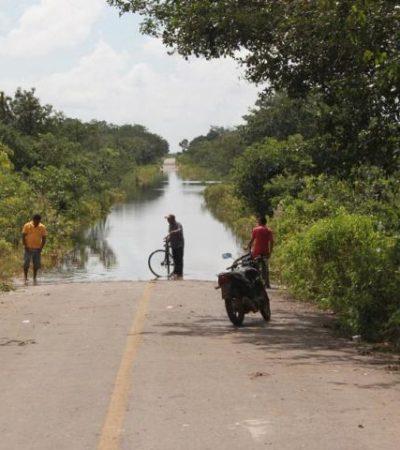 Incomunica a pobladores inundación de carretera en Zona Maya