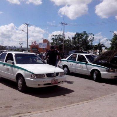 Aseguran auto robado reconvertido como taxi en Cancún