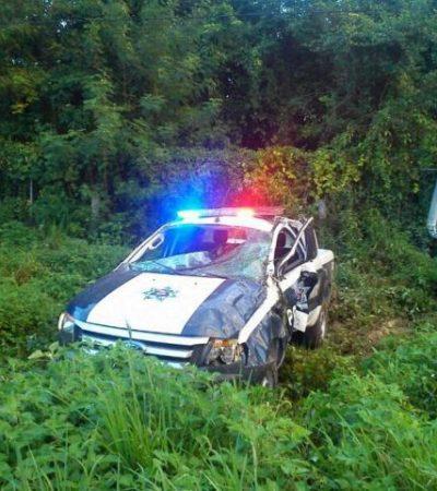 SE ACCIDENTA PATRULLA: Por exceso de velocidad, se vuelca unidad con 2 policías en la carretera Puerto Morelos-Cancún
