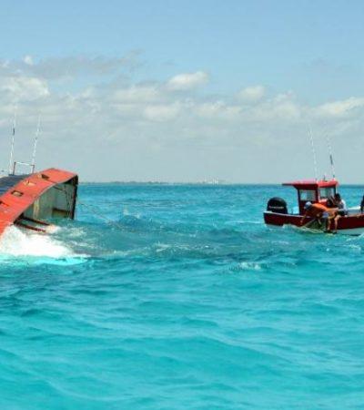 Tratan de sacar barco camaronero hundido para evitar derrame de combustible
