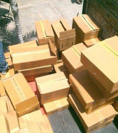 Decomisan cargamento de perfumes de contrabando afuera del mercado 'El Parián' de Cancún