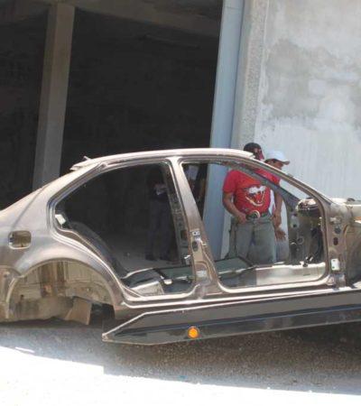 Investigan presunta red criminal detrás de bodega con autos robados en Bonfil