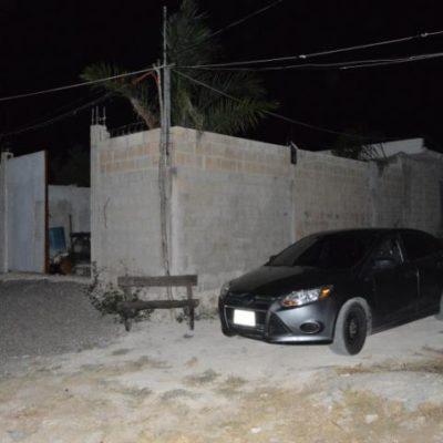 Hallan en colonia irregular tercera bodega de autos robados en Cancún