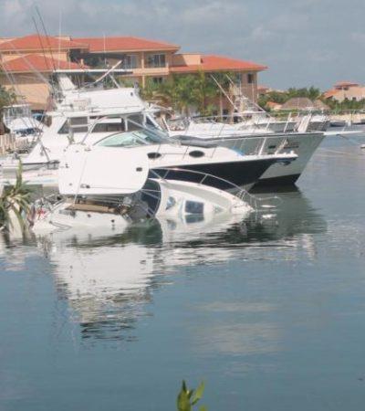 Se hunden dos embarcaciones en marina de Puerto Aventuras y derraman combustible y aceite