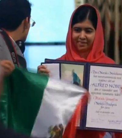 Entregan Nobel de la Paz a Malala y Satyarthi… e irrumpe en la ceremonia joven con bandera mexicana