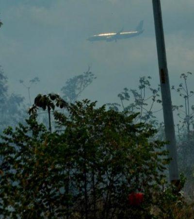 Combaten otro incendio forestal en las cercanías del aeropuerto de Cancún