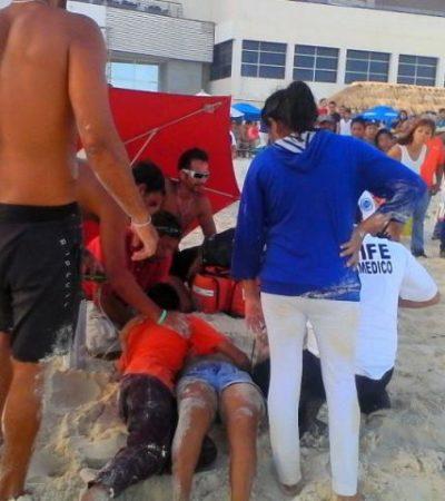 Rescatan a mujer embarazada a punto de ahogarse en playa Delfines
