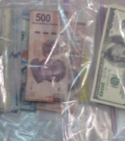 Detienen a 3 hombres y 1 mujer con más de 67 mil dólares en efectivo en el aeropuerto de Cancún