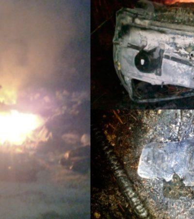 MÁS QUE EXTRAÑO: Voltean e incendian camioneta a un costado de la carretera en la salida de Playa del Carmen