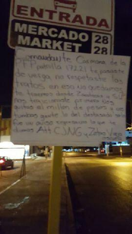 Aparece en el Mercado 28 de Cancún supuesto narcomensaje contra un policía federal