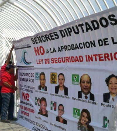 Coloca Conaci manta en Cancún contra Ley de Seguridad Interior