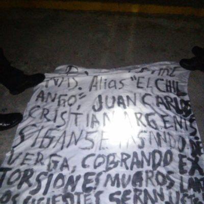 Aparecen narcomantas en Cancún con amenazas