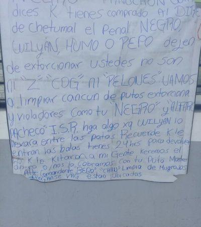 En una manta, advierten limpia de extorsionadores en Cancún