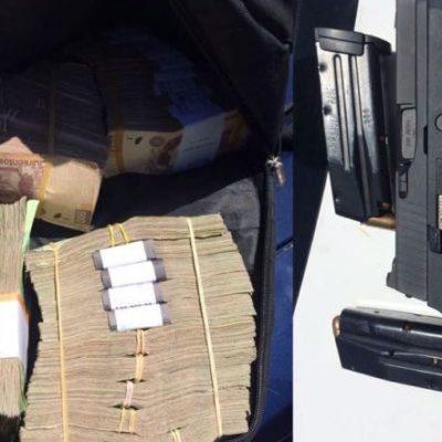 Detienen en Playa del Carmen a dos hombres que viajaban con maleta con un millón 200 mil pesos y una pistola