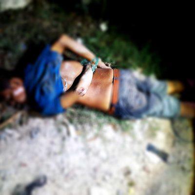 DOMINGO ENSANGRENTADO | EJECUTAN A UN HOMBRE EN CANCÚN: Encintado y con el tiro de gracia, hallan cuerpo a espaldas de 'El Torito'