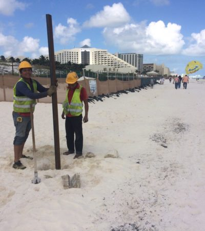 Retiran tubos de metal enterrados con cemento en la zona de playa Delfines por desarrolladores del proyecto de hotel Gran Solaris