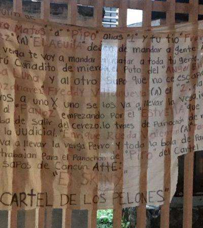 Cuelgan manta con amenazas en Región 103 de Cancún