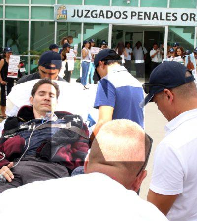 FOTOS   Postrado en una camilla, Roberto González acude a los juzgados penales en Playa para diligencia en el caso contra el llamado #LordCobarde