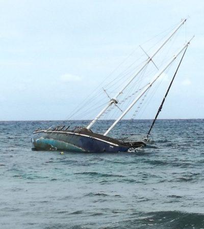 Ruso deja barco encallado en Cozumel y se va de México