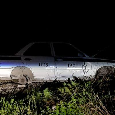 Abandonan taxi desmantelado en colonia 'Los García' de Cancún