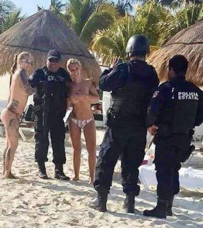 Abren investigación contra policías 'galanes' que se tomaron fotos con turistas en 'topless'