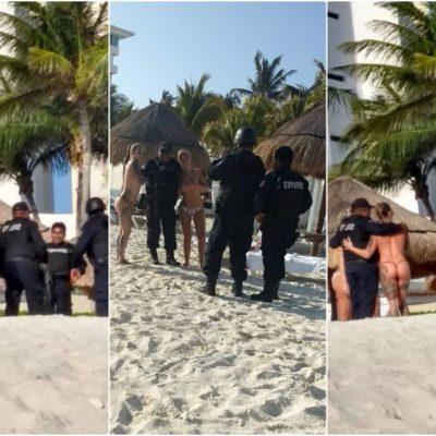 """""""LOS POLICÍAS SÓLO QUIEREN DIVERTIRSE"""": Se viralizan fotos de agentes posando con turistas en 'topless' en las playas de Cancún"""
