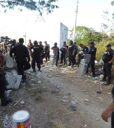 Desalojo de invasores termina con dos policías heridos y cinco detenidos