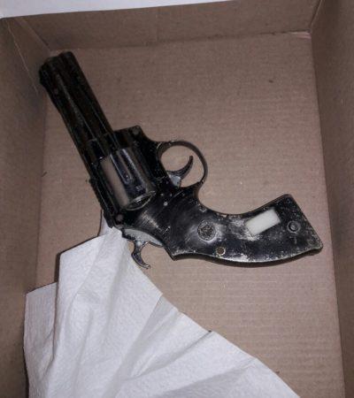 Atrapan a dos personas con arma en Cancún