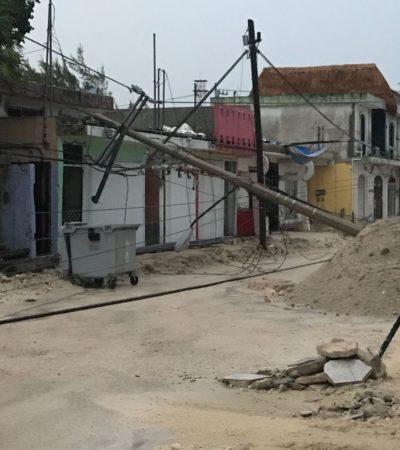 Se cae cableado de energía en casco antiguo de Puerto Morelos por tormenta eléctrica