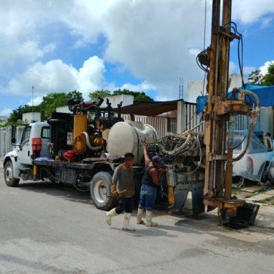 Para evitar encharmientos e inundaciones, realizan trabajos de desazolve de pozos, en Puerto Morelos