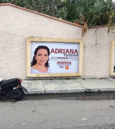 Cuelgan lona de Adriana Teissier en Cozumel y antes de tres horas 'la desaparecen'