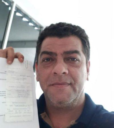 El candidato Julio 'Taquito', reintegra al Ieqroo 13.92 pesos que le sobraron de su campaña electoral