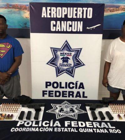 VENÍAN A VACACIONAR CON PISTOLAS Y MÁS DE 100 BALAS: Detienen a dos estadounidenses por portar armas en el aeropuerto de Cancún