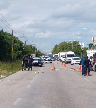 BALAZOS EN LA CARRETERA CANCÚN-PUERTO MORELOS: Reporte de disparos provoca fuerte congestionamiento vial; abandonan un arma; habría un herido