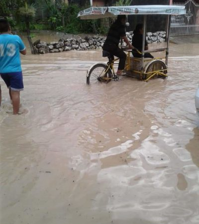Lluvia inunda calles de Chunhuhub