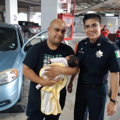 Rescatan policías a bebé encerrada en automóvil en Cancún