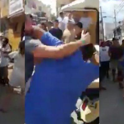 PELEAN TURISTAS CON COMERCIANTES DE ISLA MUJERES: Se viraliza video de agresión a golpes entre locales y extranjeros
