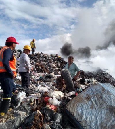 Continúa combate de incendio en tiradero de Chetumal