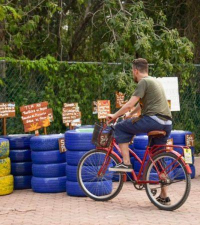 Jóvenes donan recipientes para basura hechos con material reciclado en Tulum