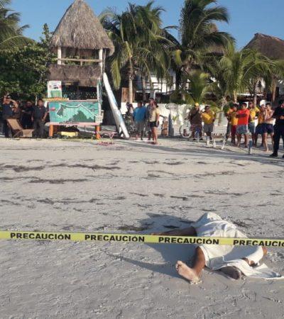 Muere turista ahogado frente a torre de guardavidas en Holbox, la cual es utilizada para información turística