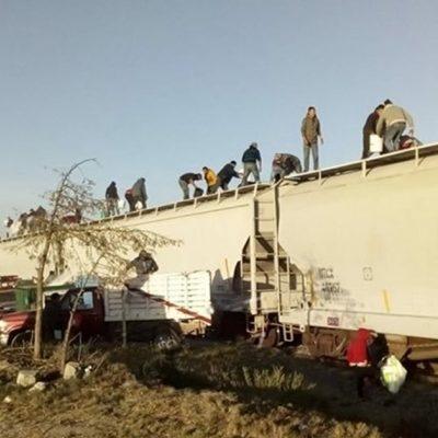 Bloquean vías del tren y una vez detenido saquean su carga en Puebla