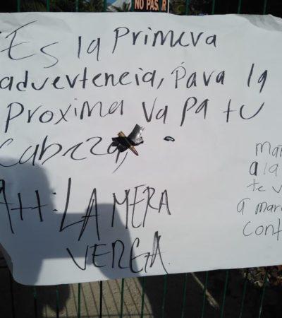 Dejan cartulina con presunto narcomensaje y cartucho útil pegado en la zona turística de Akumal
