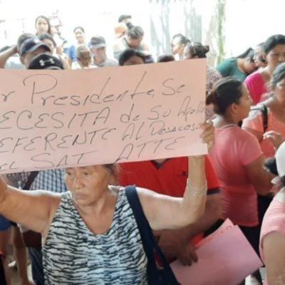 """Familias protestan contra subasta de lotes que prepara el SAT en la colonia """"Nuevo Progreso"""" por deuda de inmobiliaria"""